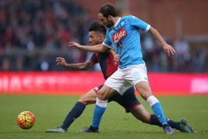 Genoa's defender Armando Izzo (L) fights for the ball with Napoli's forward Gonzalo Higuain from Argentina during the Italian Serie A  football match Genoa Vs Napoli on November 1, 2015 at the Luigi Ferraris Stadium in Genoa.  AFP PHOTO / MARCO BERTORELLO        (Photo credit should read MARCO BERTORELLO/AFP/Getty Images)